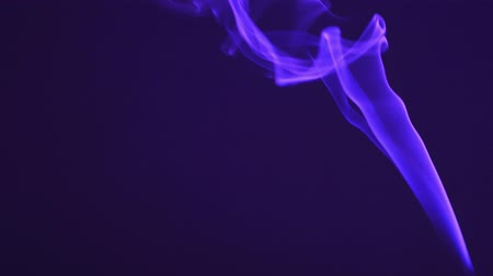 Bright blue smoke isolated against a dark background. The concept of aromatherapy, mysticism and witchcraft