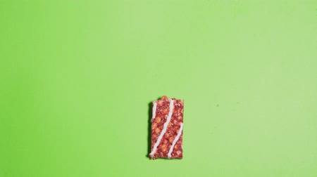 гайка : Beautiful granola bars are broken in half and taken away from the chromakey background. Stop motion isolated protein snack on a green background
