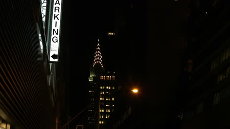 24 Hr Parking Sign And Crysler Building At Night