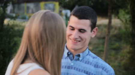 eyes closed : Man closes girls eyes with his hands for surprise Stock Footage