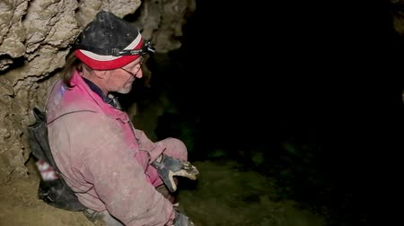 prehistory : Speleologist take interview about karst cave Stock Footage