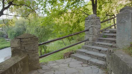 POV camera come upstairs at garden staircase, nice dim outdoors Stock Footage