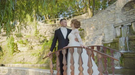 Just married couple walking in the city, bridge uhd