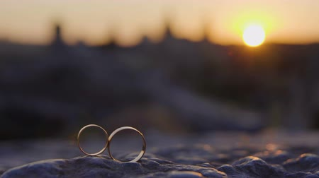 Wedding rings on sunset castle background Stock Footage