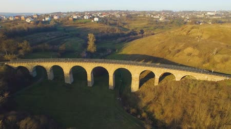 aerial shot of the stone railway bridge in sunset with interesting shadow