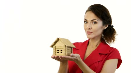 ипотека : Happy woman holding a little house in her hands Стоковые видеозаписи
