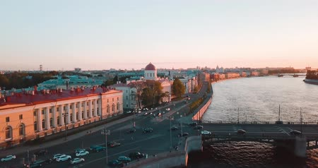 winter palace : Aerial view of sunset over Neva river in Saint Petersburg, Russia. Vasilievskiy island city from above, cinematic drone video, historical buildings of nothern capital
