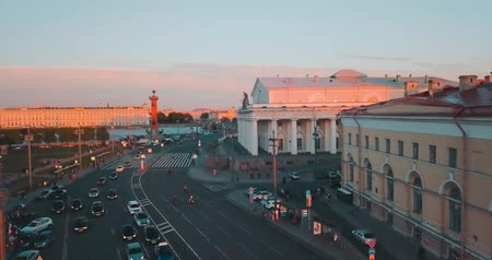 Aerial view of sunset over Neva river in Saint Petersburg, Russia. Vasilievskiy island city from above, cinematic drone video, historical buildings of nothern capital