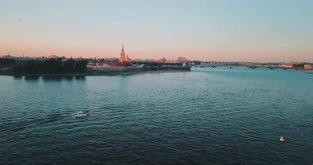 Peter and Paul fortess Aerial view of sunset over Neva river in Saint Petersburg, Russia. Vasilievskiy island city from above, cinematic drone video, historical buildings of nothern capital
