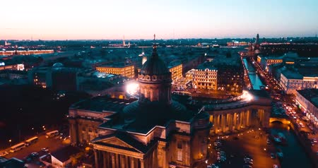winter palace : Aerial shot of Kazan Cathedal at night . Saint Petersburg, Russia. city from above, cinematic drone video, historical buildings of nothern capital.