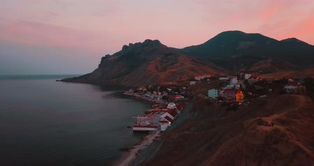 brezilya : Mountains Peaks, Sunset and sea. Epic on the edge of the mountain valley with rocks and sun flare. 4k drone flight. Aerial establisher. Europe green nature. Film vintage colors.