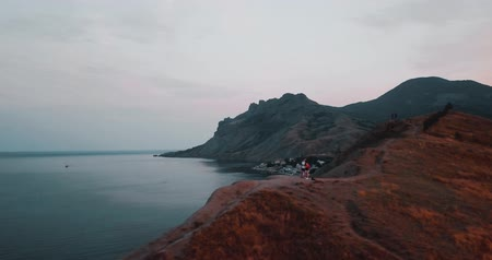 brasil : Mountains Peaks, Sunset Sea and the city. Epic on the edge of the mountain valley with rocks and sun flare. 4k drone flight. Aerial establisher. Europe green nature. Film vintage colors.