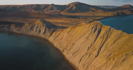 Mountains Peaks, Sunset and sea. Epic on the edge of the mountain valley with rocks and sun flare. 4k drone flight. Aerial establisher. Europe green nature. Film vintage colors.