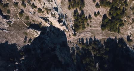 Mountains Peaks, Sunset and sea. Epic on the edge of the mountain valley with rocks and sun flare. 4k drone flight. Aerial establisher. Europe green nature. Film vintage colors. top view.