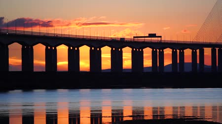 Silhouette of Bridge at Sunset, with Reflection in Sea (Severn Bridge, England  Wales)