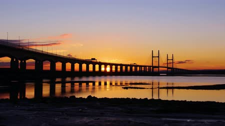 Time Lapse of Sunset Behind Bridge, with Beautiful Reflection in Water (Severn Bridge, England  Wales)