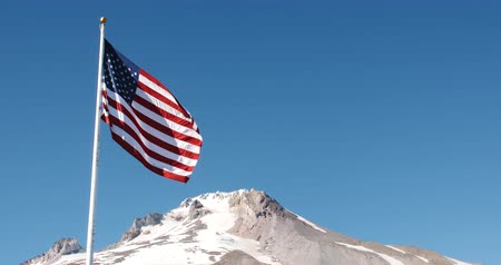 American Flag Flying, Snowcapped Mountain Peak