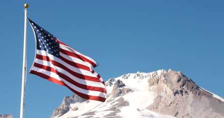 American Flag Flying, Snowcapped Mountain Peak - Close Up