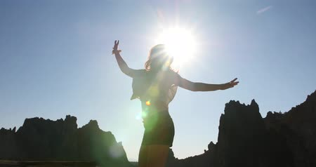 Young Woman Jumping in front of Sun, Silhouette 3