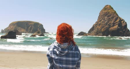 Beautiful Redhead Woman on Beach, Gazing at Ocean Waves