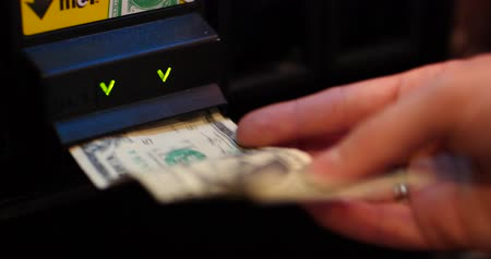 Inserting Dollar Bill into Arcade Gaming Maching