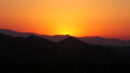 Golden Sunset Over Scenic Mountain Landscape Silhouette, Dusk in the Desert