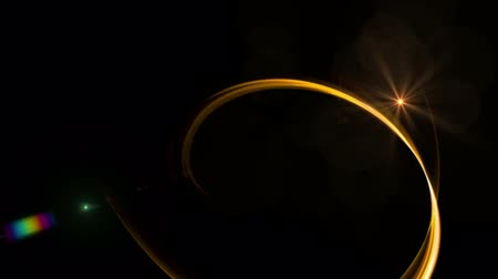 flowing lines : Dynamic Golden Rotational Motion -  Golden circular motion with starry light as a metaphor of speed and power, wavy flowing energy on black background, animation, 30fps, HD1080, seamless loop Stock Footage