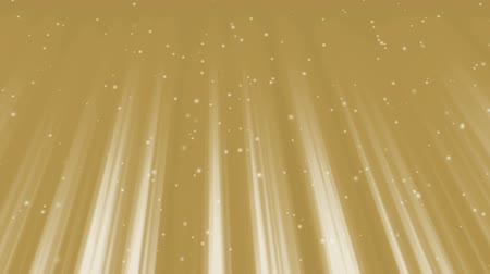 Flying, sparkling particles in rays of golden light. Defocused particles slowly floating.  Festive motion background. Animation, abstract illustration, seamless loop Стоковые видеозаписи