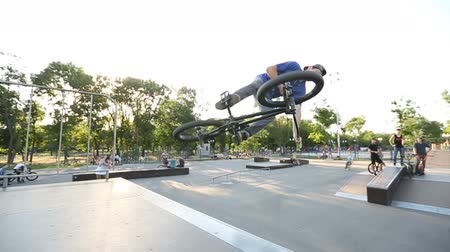 bmx : BMX rider does various tricks while riding in skatepark