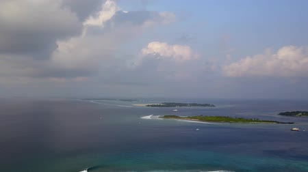 hydroplane : Aerial panorama of hydroplane flying over tropical islands on Maldives, camera follows plane above ocean in 4k