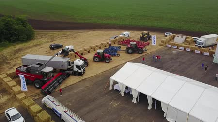 combinar : MANGUSH, UKRAINE - June 14, 2017: Aerial view of agricultural outdoor expo - Field Day, exhibition of agricultural technologies and machinery for landowners, landlords, farmers and agronomists.