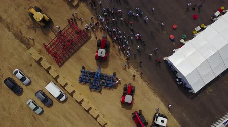 agronomist : MANGUSH, UKRAINE - June 14, 2017: Aerial view of agricultural outdoor expo - Field Day, exhibition of agricultural technologies and machinery for landowners, landlords, farmers and agronomists.