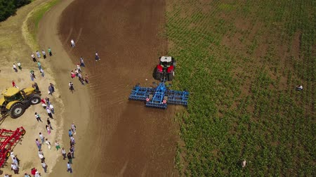 expo : MANGUSH, UKRAINE - June 14, 2017: Aerial view of agricultural outdoor expo - Field Day, exhibition of agricultural technologies and machinery for landowners, landlords, farmers and agronomists.