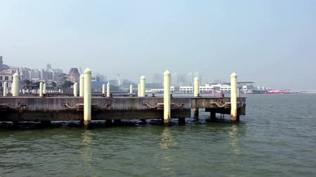 fishermen : Mooring posts at Macau Fishermans Wharf and view of Outer Harbour Ferry Terminal Stock Footage