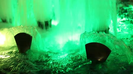 physical pressure : Beautiful fountain water and multi colored lights illumination