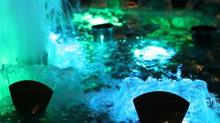 искусственный : Beautiful fountain water and multi colored lights illumination
