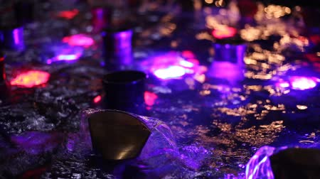 luminosidade : Beautiful fountain water and multi colored lights illumination at night Stock Footage