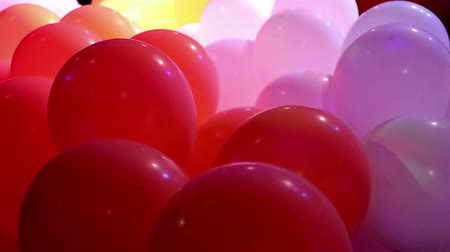 Soft focused celebration balloons and flashing colorful LED lights Vídeos