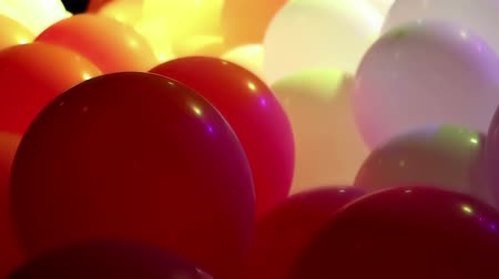 Soft focused celebration balloons and flashing colorful LED lights Wideo