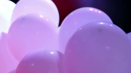 ekli : Soft focused celebration balloons and flashing colorful LED lights Stok Video