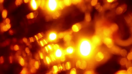 Abstract beauty. Extreme close-up of soft focused orange LED lights blinking at night, seamless video loop 動画素材