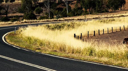 Windy rough road out in the countryside of Gatton, Queensland.