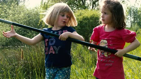 ryba : Two little girls are catching a big fish together with a big fishing rod - part 2 Dostupné videozáznamy