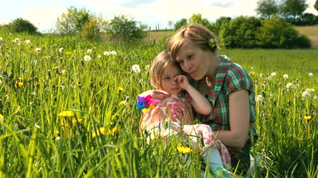hozzábújva : Mother comforts her daughter on a spring meadow