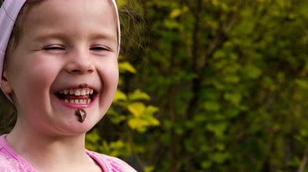 tongue out : A little girl eats chocolate cream with her finger - Part 2 Stock Footage