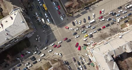view of intersection of streets in Kiev with cars, taxis, bus and people from above in 4K Stok Video