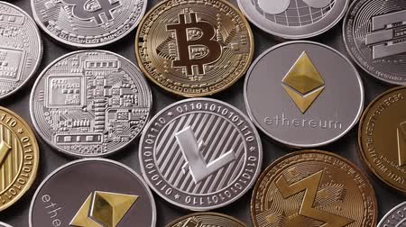 nugget : A pattern from different coins of crypto currency on a dark background. Slow motion. 1080p Full HD video Stock Footage