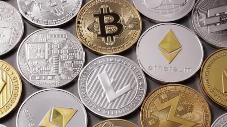 electronic exchange : A lot of metal coins of crypto currency LTC, ETH, BTC, XMR, XRP, DASH on a dark background. Slow motion. 1080p Full HD video Stock Footage