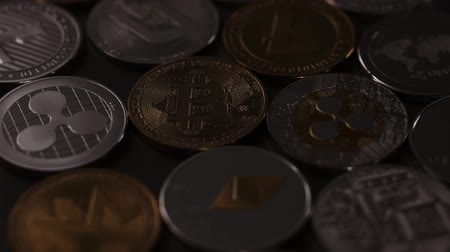 nugget : Physical metal cryptocurrency on a dark background. Digital coins cyberspace. Slow motion. 1080p Full HD video