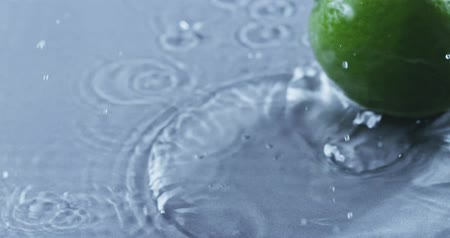 flavoring : Lime falls into the water creating a spray. Slow motion 2k video shooted on 240 fps